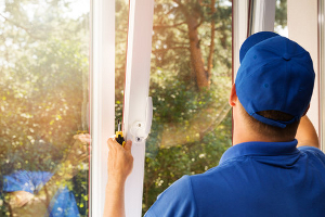 Expert from New Look Home Improvements installing a window.